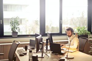 a man sitting at a computer