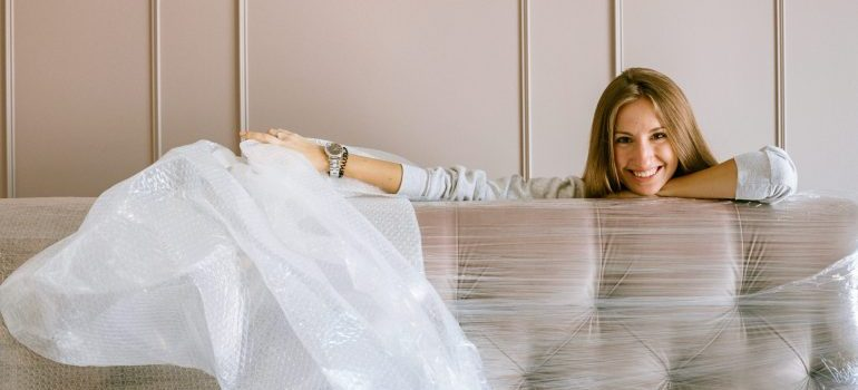 A woman with a wrapped sofa