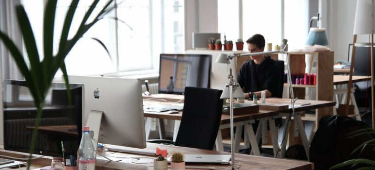 Man sitting in front of computer researching is storage a good option for small businesses