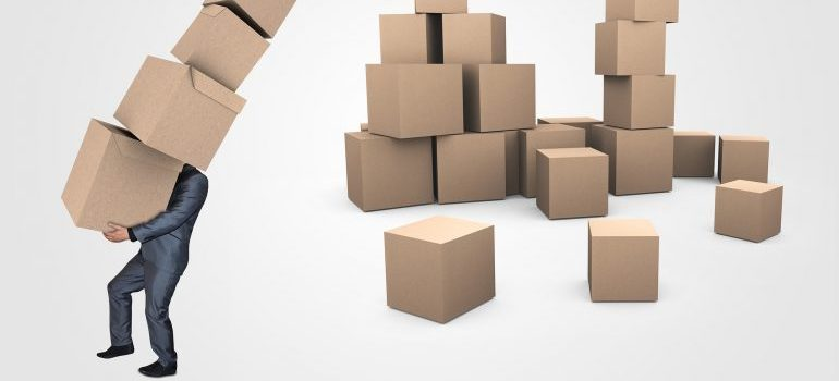 man lifting cardboard boxes