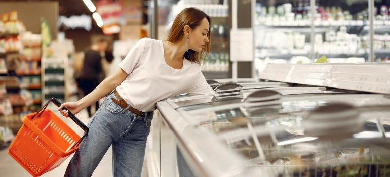 Woman collecting supplies from the supermarket