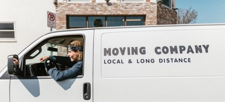 Moving company employee driving a moving truck