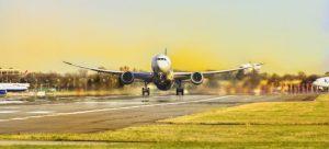 airplane landing, sunset