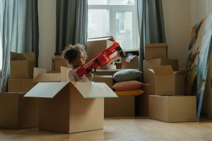 child playing with boxes