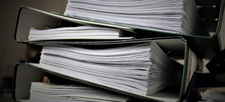 A pile of folders with papers