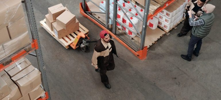 a man pulling carboard boxes on a pallet to help understand why are packaging regulations so strict