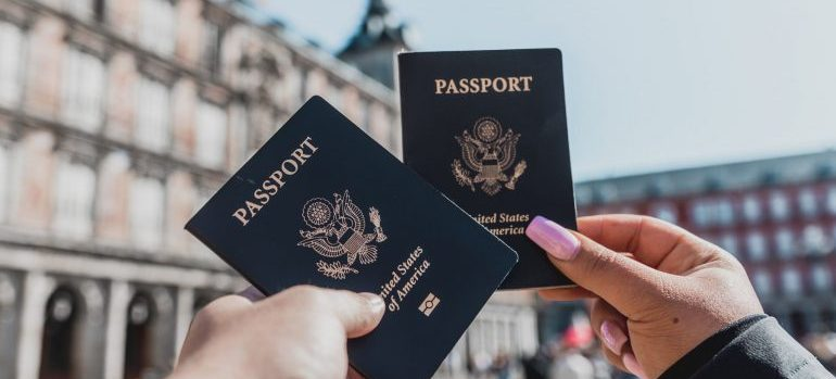 two people holding passports in the public