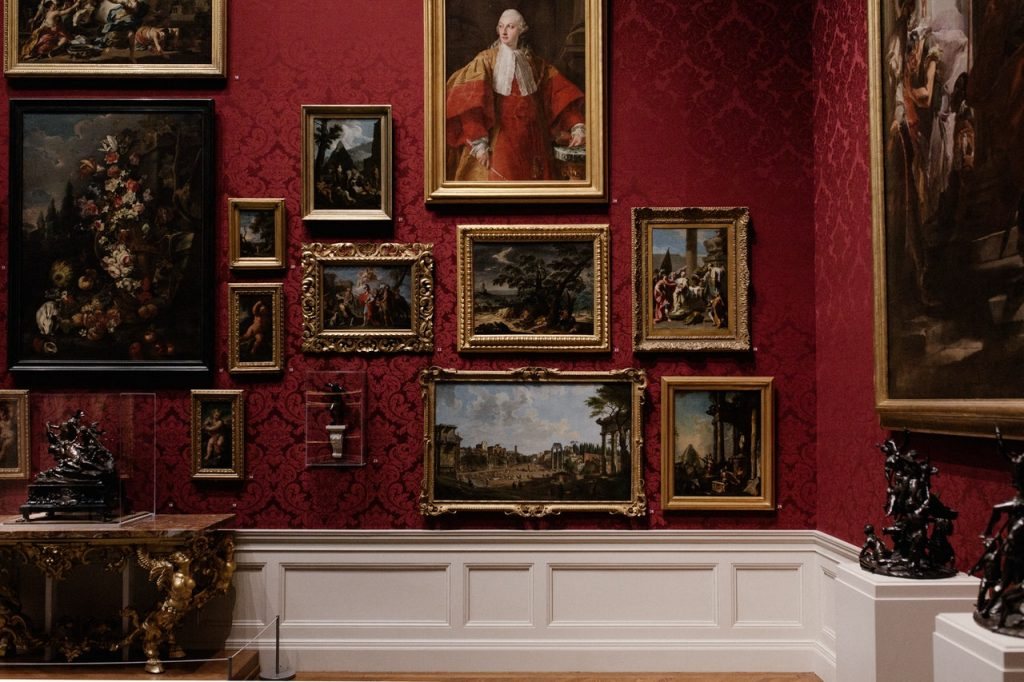 paintings on the wall of a museum