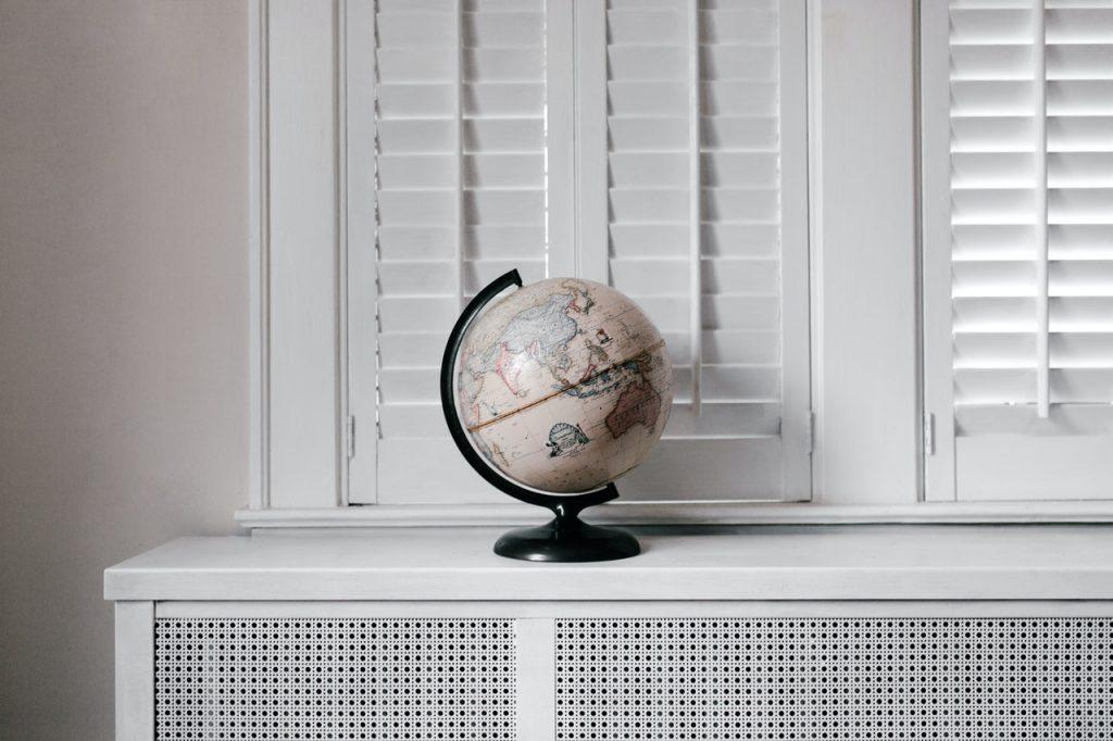 a globe by the window