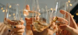 people holding glasses of wine