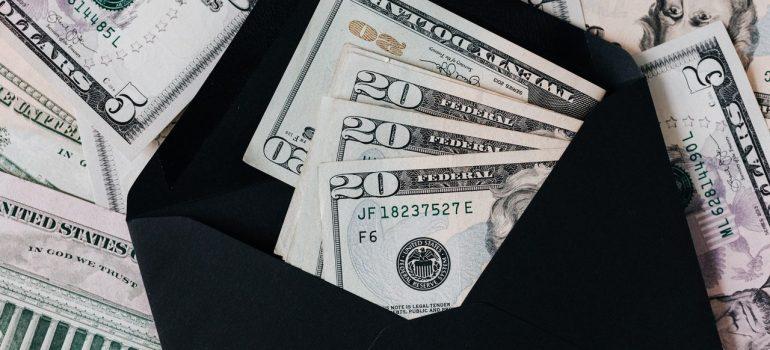 a stash of money inside a black envelope