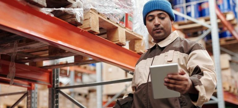 Man checking inventory in the warehouse